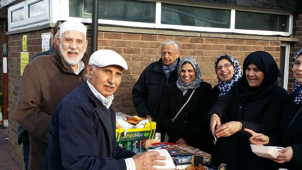"""The """"Children in Need"""" team serve tasty samosas to """"Mukhtar Ahmed and Munsif Choudry"""" Behind the stall  - Left to Right : Afzal Chaudri, Farah Anwar, Rubbiah Choudry, Shahnaz Azhar"""